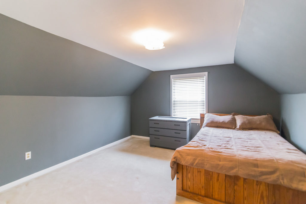 down below the basement is huge and offers tons of finished space there is a large family room with access to a large outdoor patio a separate room that bedroomknockout carpet basement family room